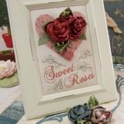 Sweet Roses ~ Brooch in frame and blue brooch below