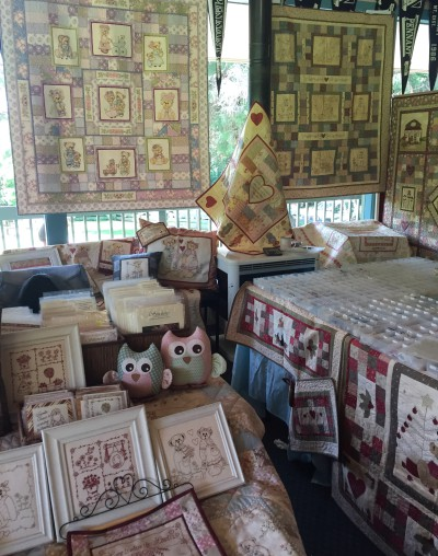 Libby Richardson designs and Embellish a Little at Quilt In 2015