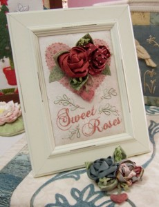 Sweet Roses ~ Brooch in frame and blue brooch below