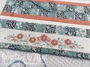 Petite Blooms Needlework Roll feature panel & braided ties